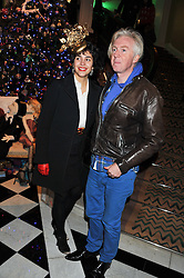 ALEXANDRA GRECO and PHILIP TREACY at the unveiling of the Claridge's Christmas tree 2011 designed by Alber Elbaz for Lanvin held at Claridge's, Brook Street, London on 5th December 2011.
