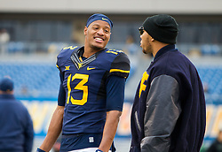 Dec 3, 2016; Morgantown, WV, USA; West Virginia Mountaineers cornerback Rasul Douglas (13) talks with Stedman Bailey before their game against the Baylor Bears at Milan Puskar Stadium. Mandatory Credit: Ben Queen-USA TODAY Sports