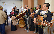 Mariachi Flores, a mariachi band from Philadelphia, Pennsylvania plays music as the congregation exits church for the combined parishes Octoberfest Sunday October 18, 2015 at Queen of the Universe Church in Levittown, Pennsylvania.  Immaculate Conception Church in Bristol closed and merged with Queen of the Universe Church last year. (Photo by William Thomas Cain)