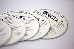 © Licensed to London News Pictures.  06/12/2012. MILTON KEYNES, UK. General view of compact discs containing Operation Rouse photographs. A total of 22 warrants were executed under the Misuse of Drugs Act in the Milton Keynes area this morning, with a further four carried out in the Metropolitan Police area and one in Northampton. 240 police officers were involved and 21 people arrested. A quantity of drugs, cash and weapons were seized. Photo credit :  LNP