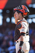 San Francisco Giants catcher Buster Posey (28) wipes his forehead in between pitches against the Los Angeles Dodgers at AT&T Park in San Francisco, Calif., on October 1, 2016. (Stan Olszewski/Special to S.F. Examiner)