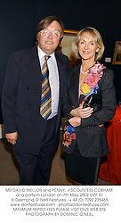 MR DAVID MELLOR and PENNY, VISCOUNTESS COBHAM at a party in London on 7th May 2002.	OZP 31