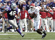 Oklahoma wide receiver Mark Clayton (9) picks up a Sooner first down with a 12-yard gain, rushing past Kansas State linebacker Brandon Archer (46) during the second quarter.  Oklahoma defeated K-State 31-21 at KSU Stadium in Manhattan, Kansas, Oct. 16, 2004.