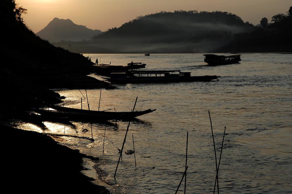 Luang Prabang. Sunset brings a magical calm to the Mekong River.