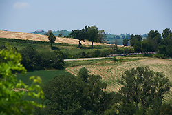 The peloton speed through the Emilia-Romagna countryside at Giro Rosa 2018 - Stage 4, a 109 km road race starting and finishing in Piacenza, Italy on July 9, 2018. Photo by Sean Robinson/velofocus.com