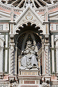 Cathedral Santa Maria del Fiore, Florence, Italy , also known as the Duomo, begun in 1296 by Arnolfo di CAMBIO, dome by Filippo BRUNELLESCHI, 1377-1446, completed in 1436. Detail of sculpture of Virgin Mary and Christ child on the facade pictured on June 8 2007.