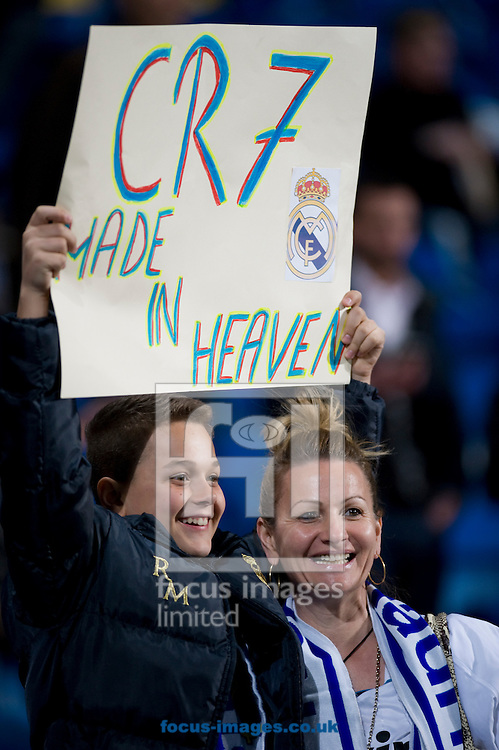 Young fan of Real Madrid supporting Cristiano Ronaldo during the La Liga match at the Estadio Santiago Bernabeu, Madrid<br /> Picture by Marcos Calvo Mesa/Focus Images Ltd +34 654142934<br /> 23/03/2014