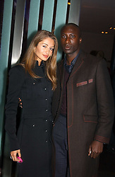 Fashion designer OZWALD BOATENG and his wife GYUNEL at a party to celebrate the opening of the Absolut Icebar London, 134 Heddon Street, London on 29th September 2005.<br />