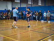 12 DECEMBER 2019 - DES MOINES, IOWA: ANDREW YANG handles the ball during a basketball game with J.D. Scholten in the gym in the Ames, IA, City Hall. Scholten is an Iowa Democrat running against Republican Congressman Steve King. Yang, an entrepreneur, is running for the Democratic nomination for the US Presidency in 2020. He brought bus tour to Ames, IA, Thursday. Iowa hosts the the first election event of the presidential election cycle. The Iowa Caucuses will be on Feb. 3, 2020.       PHOTO BY JACK KURTZ