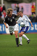 28.07.2004, Hyvink??, Finland..UEFA Women's Under-19 European Championship.Group A, Finland v Germany.Angelika Feldbacher (Germany) v Sari Hyyrynen (Finland).©Juha Tamminen.....ARK:k