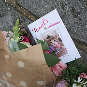 London,England,UK, 24th March 2017: A message written 'It was a Monster not a Muslim' Flower tributes for the victims of terror attacks near Parliament square,London,UK. by See Li