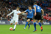 England midfielder Adam Lallana attempts to cross watched by Estonia defender Karol Mets during the Group E UEFA European 2016 Qualifier match between England and Estonia at Wembley Stadium, London, England on 9 October 2015. Photo by Alan Franklin.