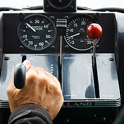 A pilot adds fuel to the engine of a DeHaviland Beaver in preparation for take-off from the Lake Hood airstrip in Anchorage Alaska.