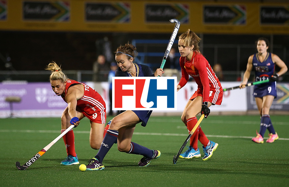 JOHANNESBURG, SOUTH AFRICA - JULY 20:  Loren Shealy of United States of America takes a shot at goal under pressure from Susannah Townsend of England during day 7 of the FIH Hockey World League Women's Semi Finals semi final match between England and United Staes of America at Wits University on July 20, 2017 in Johannesburg, South Africa.  (Photo by Jan Kruger/Getty Images for FIH)