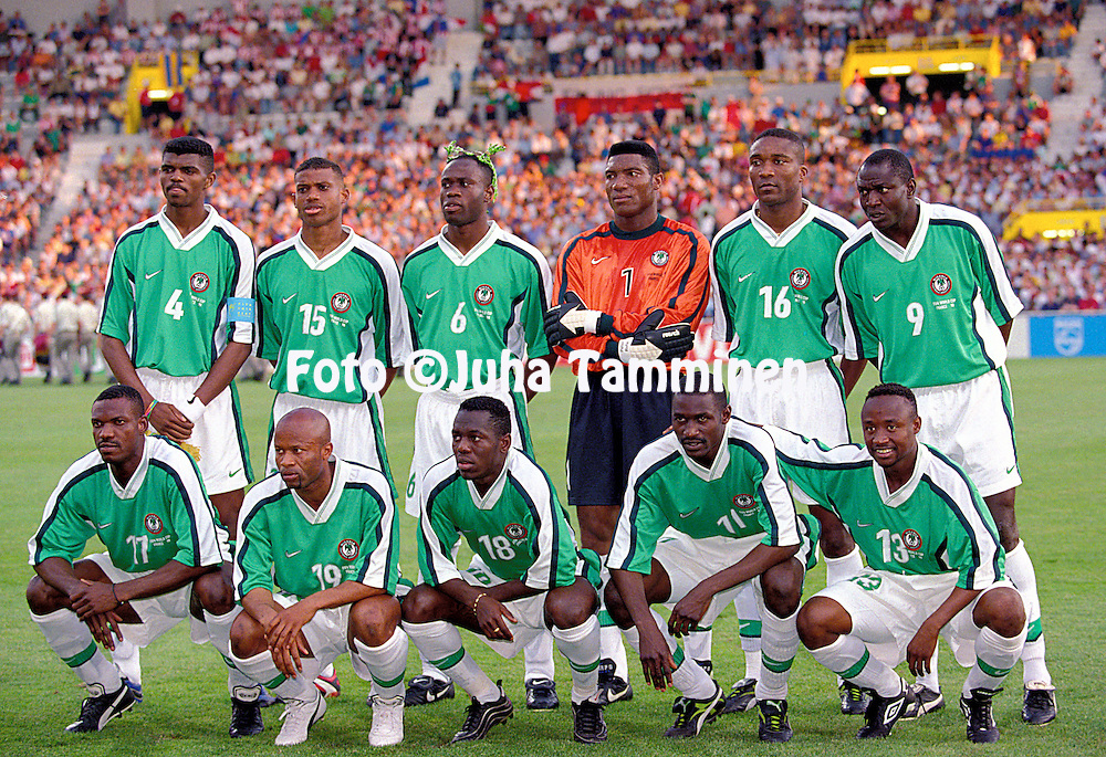 FIFA World Cup - France 1998<br /> 24.6.1998, Stade Municipal, Toulouse, France.<br /> Group D, Nigeria v Paraguay<br /> Nigeria line up, standing from left: Nwankwo Kanu, Sunday Oliseh, Taribo West, Peter Rufai, Uche Okafor, Rasheed Yekini.<br /> Kneeling; Augustine Eguavoen, Ben Iroha, Wilson Oruma, Garba Lawal, Tijani Babangida.