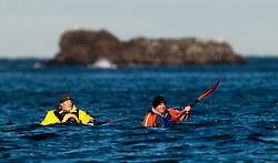 Olly Jay. Scottish Sun sports editor Iain King tales part in a practise session for his charity kayak challenge, in the waters of the harbour at St Abbs..Pic © Michael Schofield...