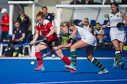 Surbiton's Georgie Twigg is watched by Sarah Jones of Holcombe. Holcombe v Surbiton - Investec Women's Hockey League Final, Lee Valley Hockey & Tennis Centre, London, UK on 23 April 2017. Photo: Simon Parker