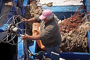 Fisherman in his boat, Mondello, Palermo.<br /> pescatore a Mondello, Palermo