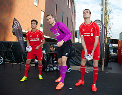 LIVERPOOL, ENGLAND - Thursday, April 10, 2014: Liverpool's Philippe Coutinho Correia, goalkeeper Simon Mignolet and Jordan Henderson throw out signed balls into the crowd at the launch of the new Warrior home kit for 2014/2015 at the Liverpool One shopping centre. (Pic by David Rawcliffe/Propaganda)