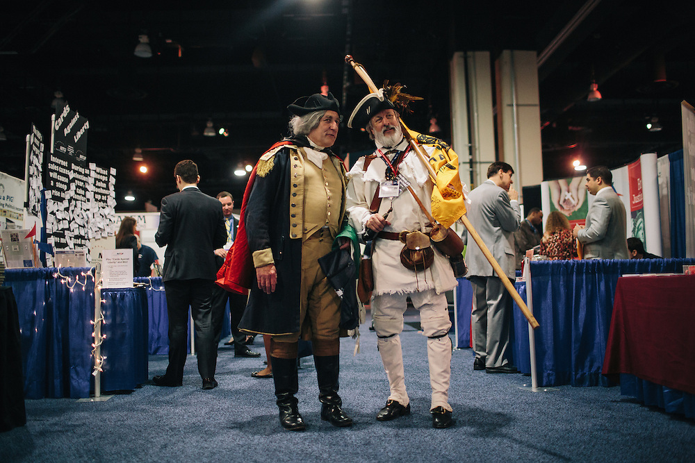 "James ""States"" Manship, 60, left, dressed as George Washington and William Temple, 63, dressed as a minute man, walk through the HUB during day two of the Conservative Political Action Conference (CPAC) at the Gaylord National Resort & Convention Center in National Harbor, Md."