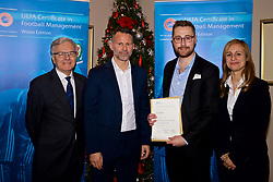 NEWPORT, WALES - Wednesday, December 12, 2018: Aron Hughes receives his certificate from Wales national team manager Ryan Giggs alongside Jean-Loup Chappelet, UEFA CFM Dean (L) and Valentina Mercolli, UEFA HatTrick Programme Manager (R) during the UEFA Certificate of Football Management Graduation Ceremony in the 2010 Clubhouse at the Celtic Manor Resort. (Pic by David Rawcliffe/Propaganda)