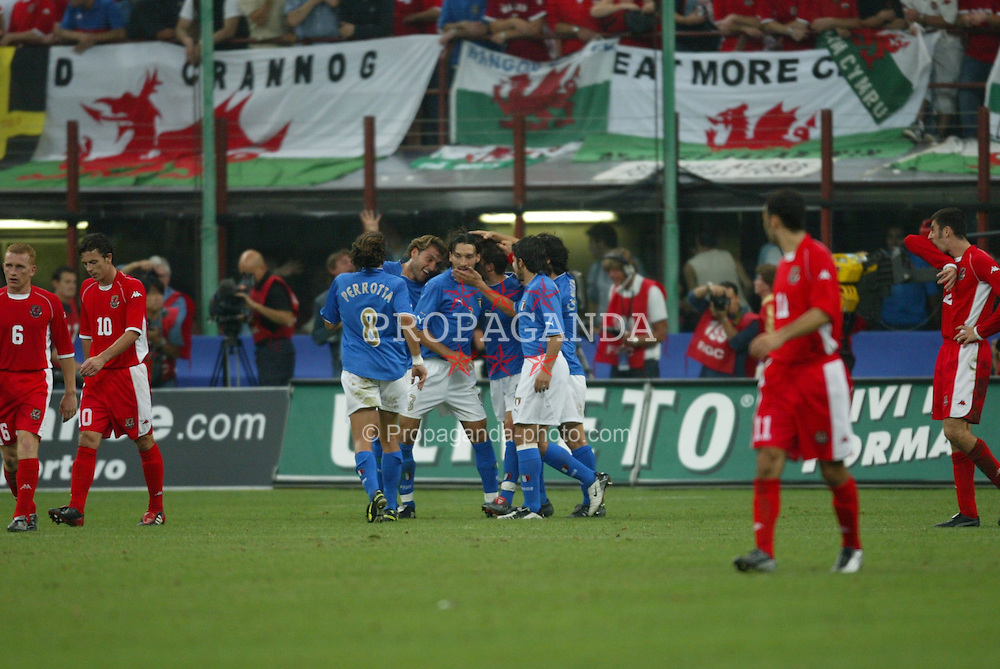 MILAN, ITALY - Saturday, September 6, 2003: Wales' Ryan Giggs looks on dejected as Italy celebrate their fourth goal during the Euro 2004 qualifying match at the San Siro Stadium. (Pic by David Rawcliffe/Propaganda)