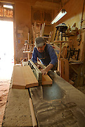 Carpenter at work in his workshop