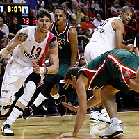 22 January 2012: Miami Heat shooting guard Mike Miller (13) drives by Milwaukee Bucks point guard Beno Udrih (19) as he falls during the Milwaukee Bucks 91-82 victory over the Miami Heat at the AmericanAirlines Arena, Miami, Florida, USA.