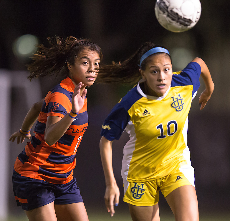 November 2, 2016; UC Irvine player Jessica Miclat (10) and Cal State Fullerton forward Connie Caliz (7) battle for the ball Fullerton College vs UC Irvine Womens Soccer Semi Final at Big West Conference at LBSU ; Long Beach, CA;  <br /> &copy; photo by Catharyn Hayne/Sport Shooter Academy