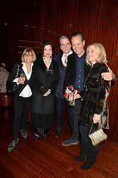 Left to right, JOAN WASHINGTON, BIANCA JAGGER, JEREMY IRONS, RICHARD E GRANT and SINEAD CUSACK at a dinner hosted by Liberatum to honour Francis Ford Coppola held at the Bulgari Hotel & Residences, 171 Knightsbridge, London on 17th November 2014.