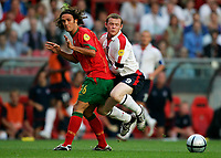 Lisbona 24/6/2004 <br />Euro2004 Quarter Final <br />Portugal England 8-7 after penalties (2-2) <br />Ricardo Carvalho of Portugal and Wayne Rooney of England<br />Photo Andrea Staccioli Graffiti