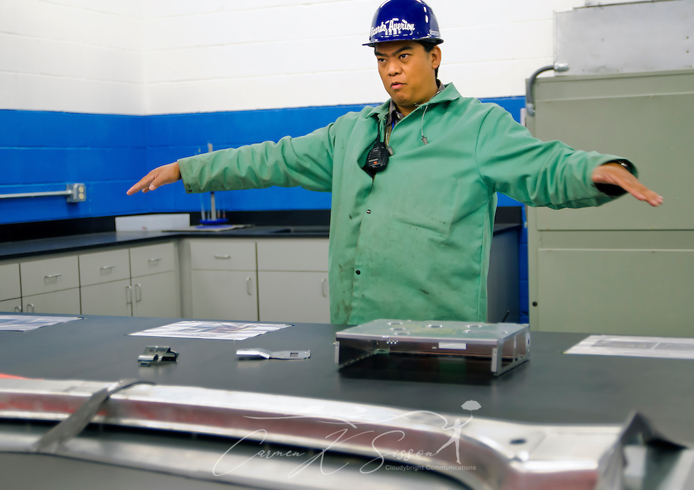 Severstal employee Ricardo Averion discusses the plant's expansion into supplying steel to the automaking industry during an open house and tour of the plant facilities, Oct. 22, 2011. In the foreground is an example of one of the types of products Severstal is now supplying to automakers. (Photo by Carmen K. Sisson/Cloudybright)