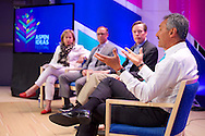 "Joan Dempsey of Booz Allen Hamilton moderates the ""Global Trends That Affect us All: Are We Ready?"" panel at the 2014 Aspen Ideas Festival in Aspen, CO. ©Brett Wilhelm"