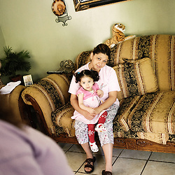 Rocio and her daughter Valentina. She was planning an abortion since she accordingly had too many kids and not enough money, but pro-life activists convinced her not to. Wichita, KS. 2009, June 20th. Photo: Antoine Doyen