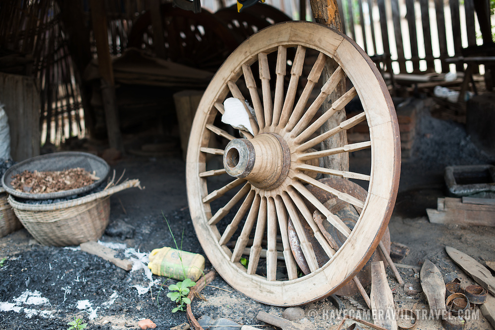 A wagon wheel for an ox cart sits in a repair workshop in Minnanthu Village in Bagan, Myanmar. Set amidst the archeological ruins of the Plain of Bagan, the tiny Minnanthu Village retains the traditional way of life.