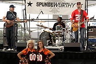 SpungeWurthy plays 'Welcome to the Jungle' as Ben-Gal cheerleaders Laura of Springboro (left) and Jill of West Carrollton stop by on a tour of Taste of Miami Valley and Home Show in downtown Dayton, Saturday, September 18, 2010.
