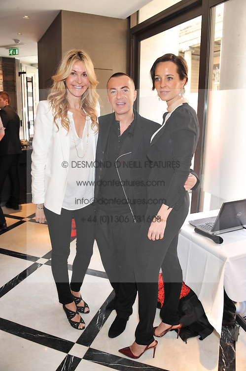 Left to right, MELISSA ODABASH, JULIAN MACDONALD and JULIA BRANGSTRUP at a lunch to launch Cash & Rocket on Tour 2013 hosted by Julia Brangstrup in aid of Orpan Aid and Shine on Sierrra Leone held at Banca, 40 North Audley Street, London on 29th April 2013.