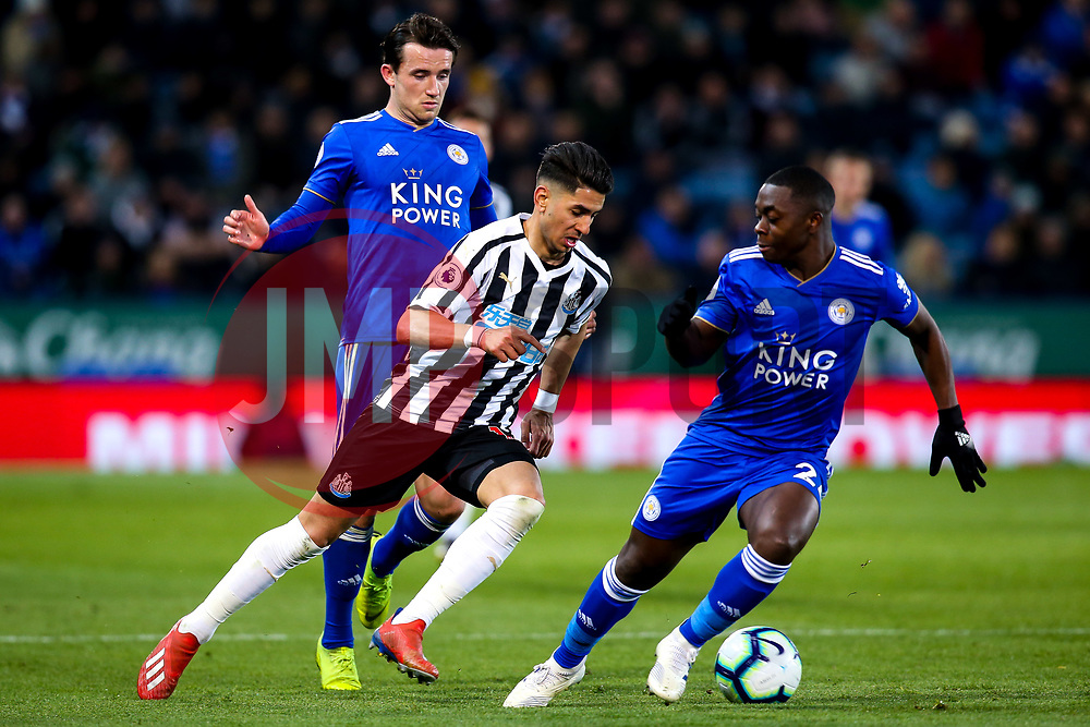 Ayoze Perez of Newcastle United takes on Ben Chilwell of Leicester City and Nampalys Mendy of Leicester City - Mandatory by-line: Robbie Stephenson/JMP - 12/04/2019 - FOOTBALL - King Power Stadium - Leicester, England - Leicester City v Newcastle United - Premier League