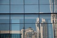Edificios de la ciudad reflejados en ventanas. Panama, 25 de enero de 2012.(Victoria Murillo/Istmophoto)