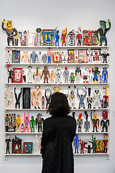 """© Licensed to London News Pictures. 01/11/2016. London, UK. A staff member views """"Fanagalo Store"""" by Norman Catherine, est. GBP10-15k. The first look of """"Bowie / Collector"""", artworks from the late David Bowie's personal art collection, ahead of their sale later this month at Sotheby's. Photo credit : Stephen Chung/LNP"""