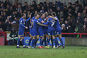 Lyle Taylor of AFC Wimbledon nets his 12th goal of the season and celebrates to put the Dons 4-0 up during the Sky Bet League 2 match between AFC Wimbledon and Luton Town at the Cherry Red Records Stadium, Kingston, England on 13 February 2016. Photo by Stuart Butcher.