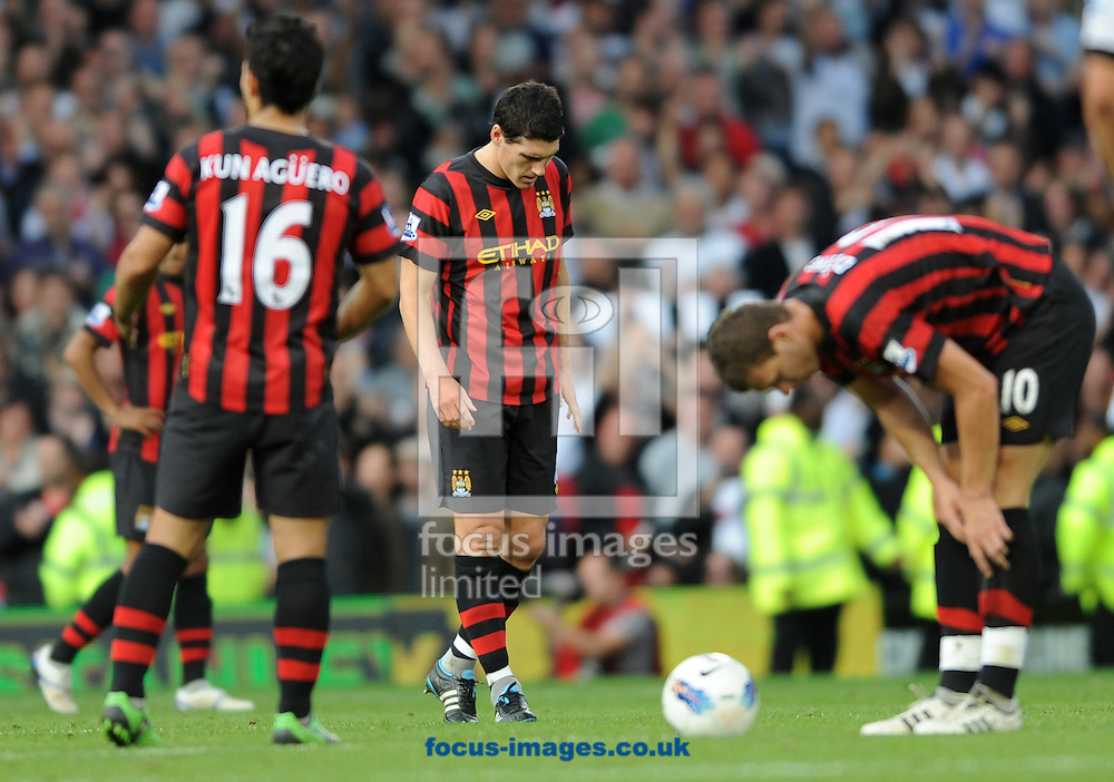 Picture by Daniel Hambury/Focus Images Ltd. 07813 022858.18/9/11.L-R Sergio Aguero, Gareth Barry and Edin Dzeko of Manchester City show dejection after conceding a tw goal lead during the Barclays Premier League match at Craven Cottage stadium, London.