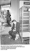 Man slumped asleep in late-night grocery shop  doorway. Shaftesbury Ave, Soho. London.5 December 1997<br /> Film 97694f15<br /> © Copyright Photograph by Dafydd Jones<br /> 66 Stockwell Park Rd. London SW9 0DA<br /> Tel 0171 733 0108