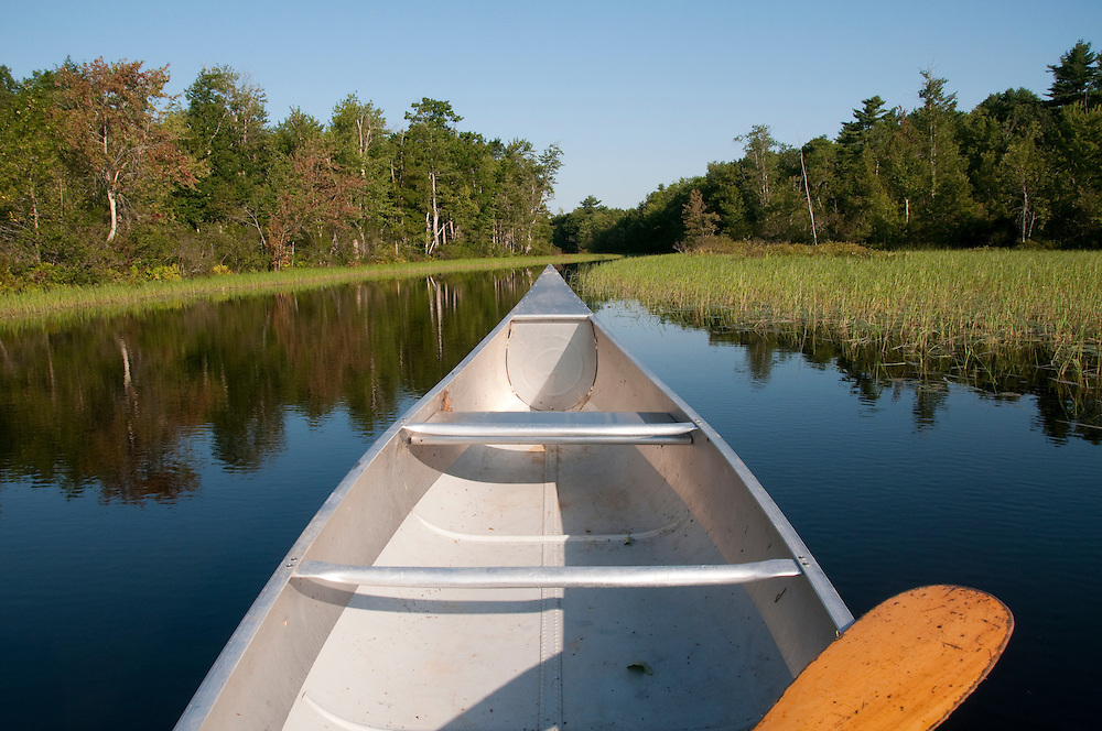 Canoe on Pleasant Pond , Maine USA