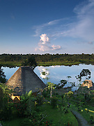 View of Napo Wildlife Center, Añangu Lake and the Amazon at sunset, Ecuador. The ecoresort is owned and managed by Quechua Indians living in the nearby community of Añangu. Next to the massive private reserve is Yasuni National Park.