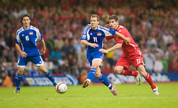 CARDIFF, WALES - Saturday, October 11, 2008: Wales' Ched Evans and Liechtenstein's Franz Burgmeier during the 2010 FIFA World Cup South Africa Qualifying Group 4 match at the Millennium Stadium. (Photo by Gareth Davies/Propaganda)