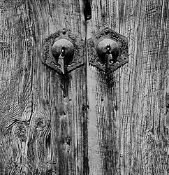 Detail of old handles on wooden door in a hutong in Beijing