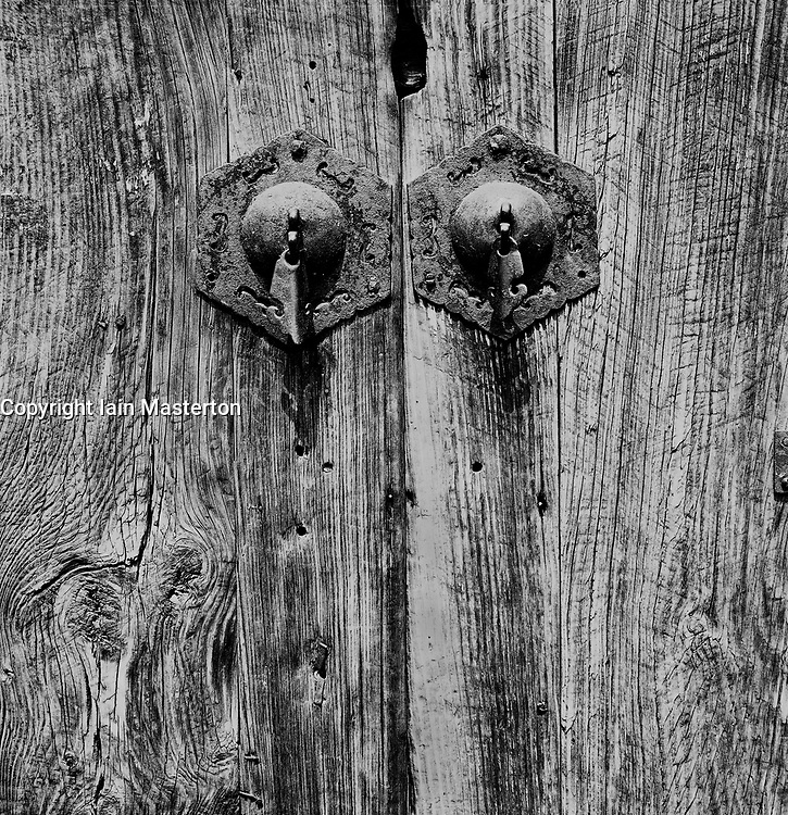 Detail of old handles on wooden door in a hutong in Beijing