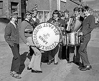 "Members of Victoria Accordian Band, Sandy Row, Belfast, get ""warmed up"" for the Twelfth march to the Field at Edenderry on the outskirts of Belfast. 197407120389a<br />