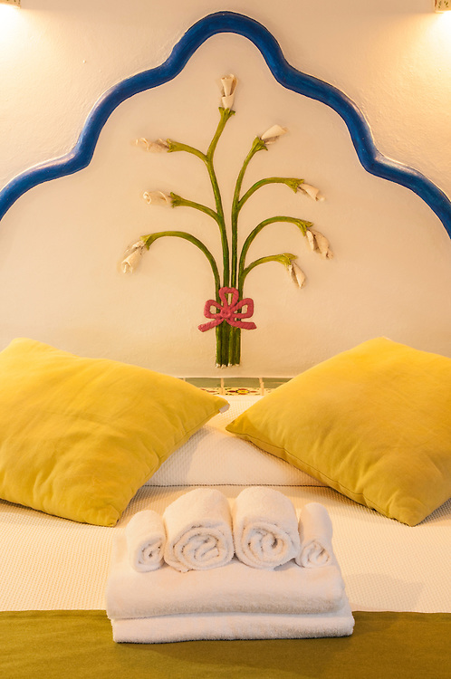 Bed in oceanfront suite at Mahekal Resort, Playa del Carmen, Riviera Maya, Mexico.